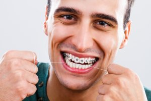 how to floss teeth properly