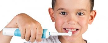 child using an electric toothbrush