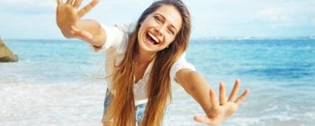 carefree woman smiling on a beach