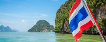View of Thai islands and flag from a boat