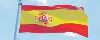 Spanish flag flying in blue sky