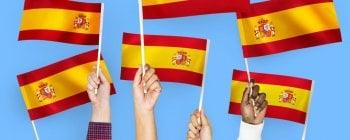 People waving Spanish flags