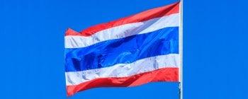 Thai flag against blue sky