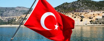 view from sea with Turkish flag
