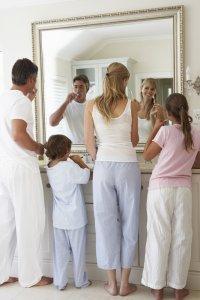 family brushing their teeth