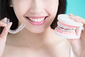 braces vs invisalign costs uk