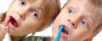 children with toothbrushes