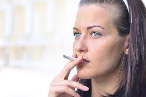 woman smoking with halitosis