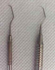 Instrumentos manuales para quitar el sarro