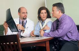 couple talking with a medical consultant