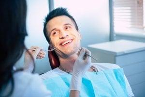 Man receiving dental implant consultation